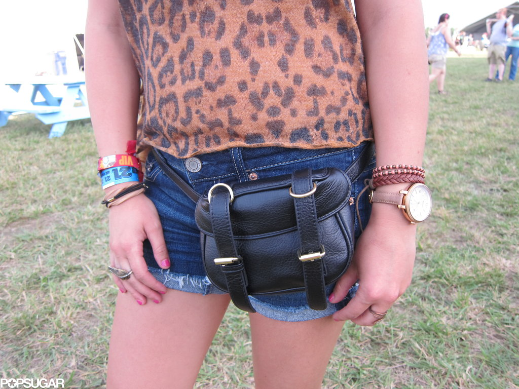 Her sleek, black belt bag, mix of bracelets, and oversize-face watch supplied the leopard print with sleek undertones.