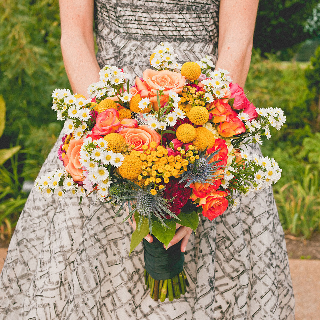 Kristin worked with her florist to create a charming bouquet of roses, burgundy cockscomb, yellow tansy yarrow, white asters, and craspedia. Related: 30 Ways to Wow Your Guests Source: Sweet Little Photographs