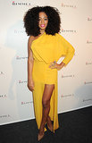 Solange Knowles hit the black carpet in a sunny asymmetrical gown and au naturel locks in London.