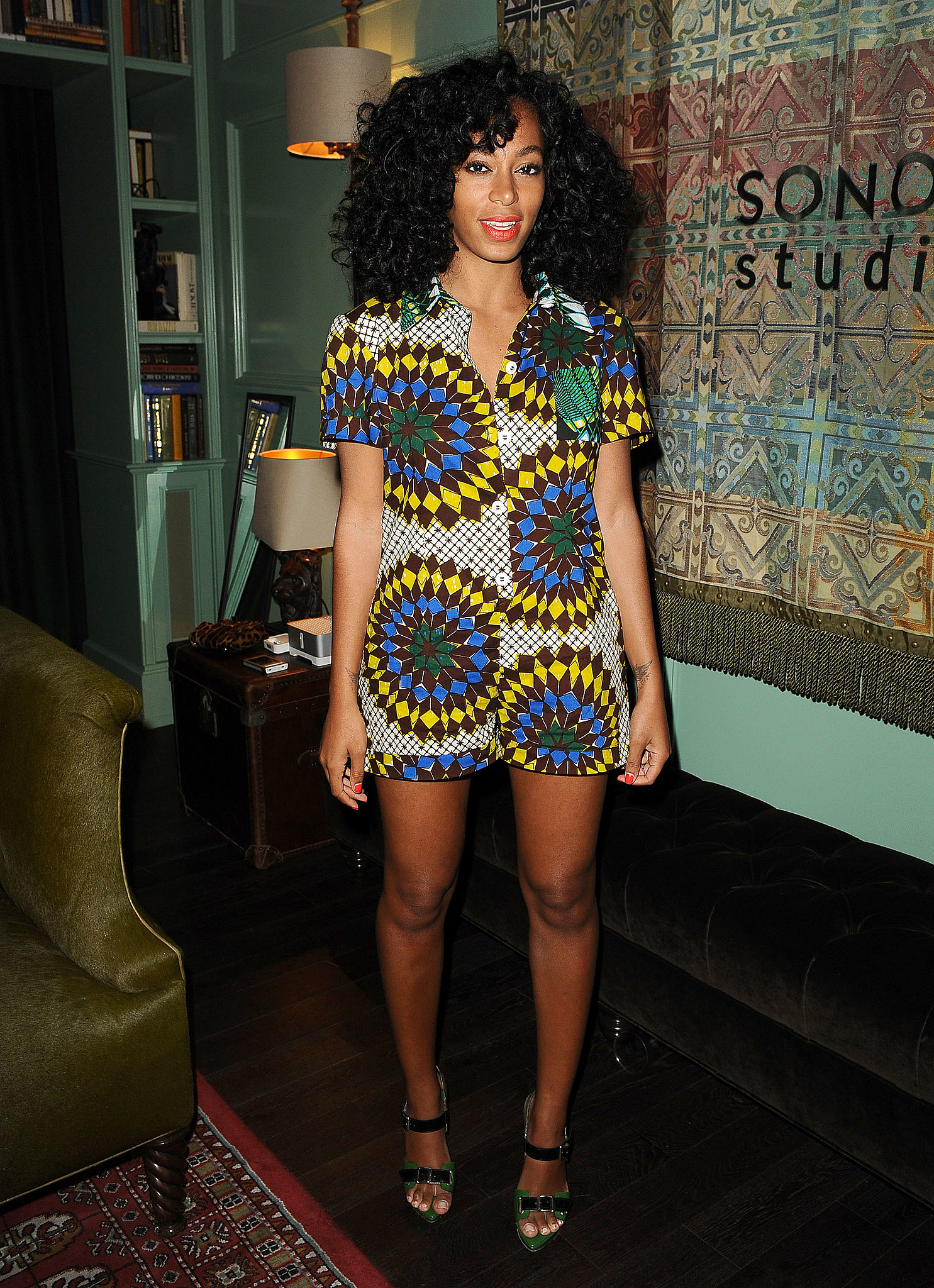 Knowles worked a brilliant, playful Boxing Kitten romper with green-and-black buckle sandals for a listening party in November 2012.