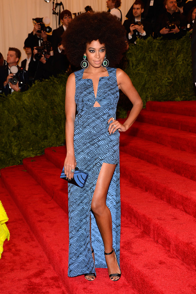 Knowles was perfectly poised in a standout Kenzo gown and jaw-dropping statement earrings at the 2013 Met Gala.