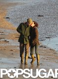 In January 2012, Kate Middleton gave Prince William a kiss while they strolled along a beach in Wales.