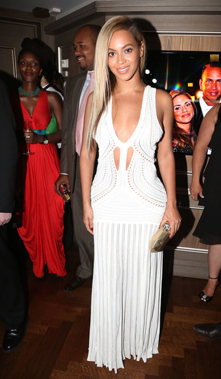 Beyoncé showed off her curves in a formfitting white Roberto Cavalli maxi dress featuring a deep-V neckline and mini cutouts at the 10-year anniversary for Jay-Z's 40/40 Club in NYC.