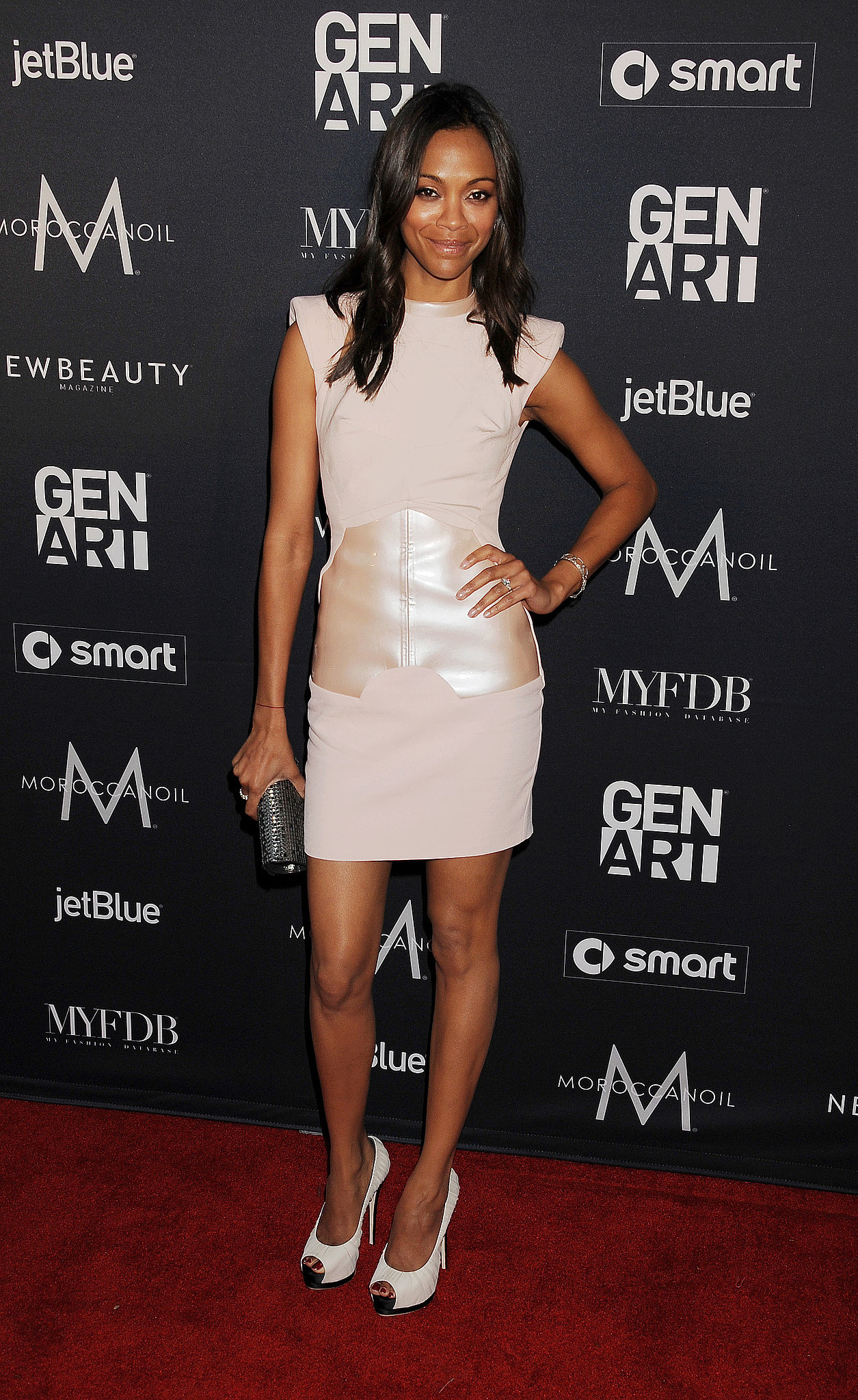 Zoe stepped out in this slick nude-toned Antonio Berardi minidress and white peep-toe Giuseppe Zanotti pumps at the Gen Art Fresh Faces event in LA last October.