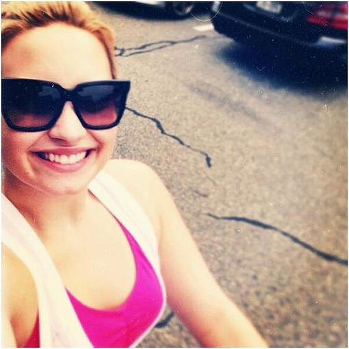 Demi Lovato showed off a bright top and cool sunglasses. Source: Twitter user ddlovato