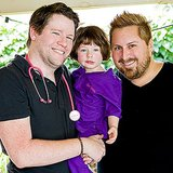 Scrubs-clad Bill Masterson and Scout Horn posed with their own little Doctor at the party.  Source: Jenny Cookies