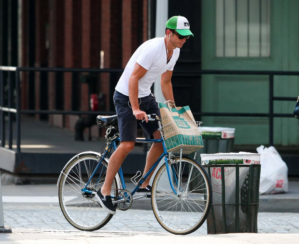 Will Arnett pedaled his bicycle through NYC after a June 2012 trip to the grocery store.