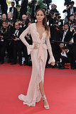 Joan Smalls was sweet and sexy in a blush lace plunging gown and matching sandals at the 2013 Cannes Film Festival.