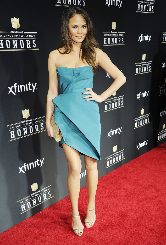 Chrissy Teigen was stylishly futuristic in a teal, strapless origami-inspired dress at the 2013 NFL Honors event in New Orleans, LA.