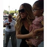 Mariah Carey carried her daughter, Roe, past fans at the airport.  Source: Instagram user mariahcarey