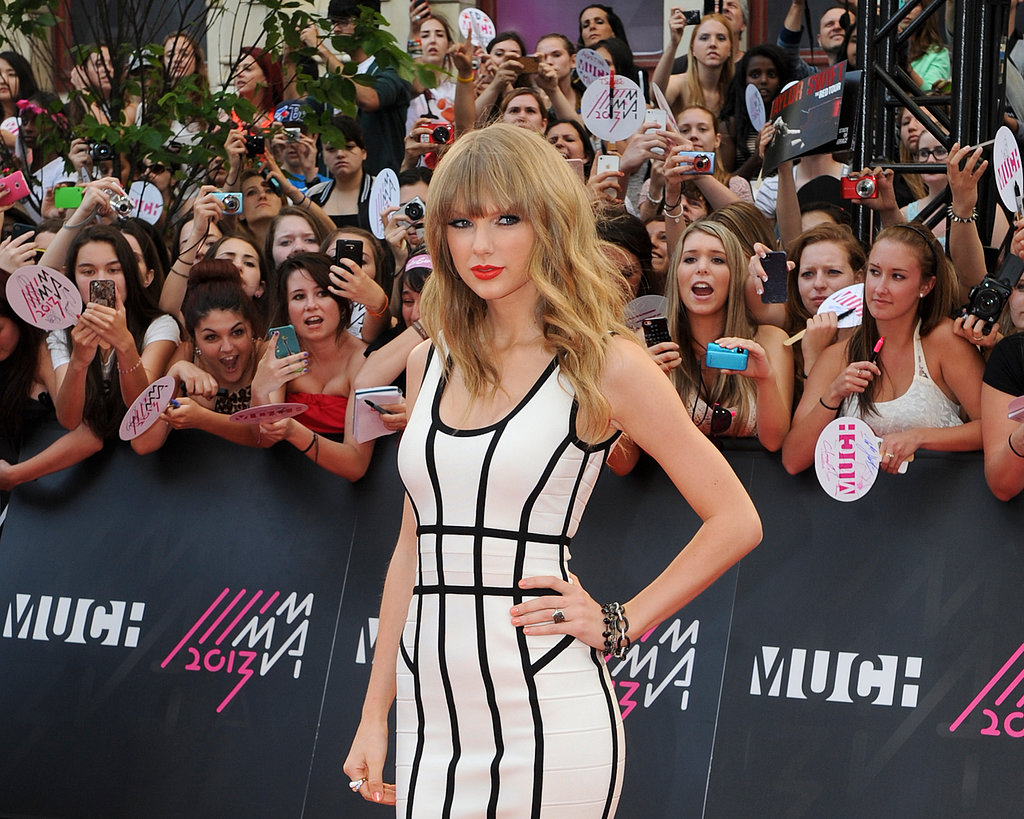 Taylor Swift was looking white-hot on the red carpet as she made her way into the MuchMusic Awards in Canada on June 16.