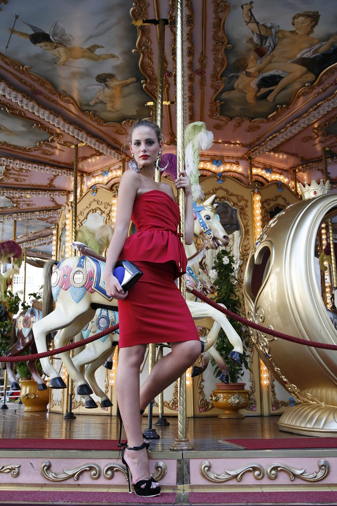 Talk about red hot! A ladylike peplum silhouette gets a shot of heat with a stretch wool dress ($1,150) from DSquared.