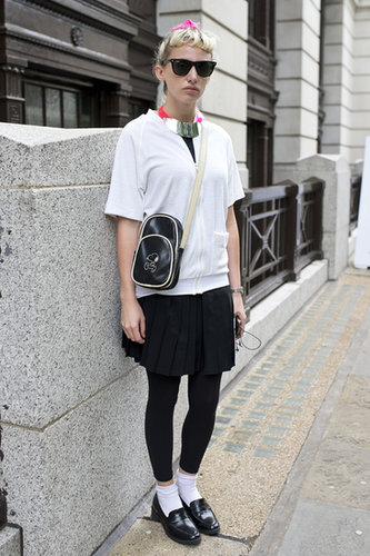 Preppy with spunk — i.e. loafers with socks, a statement necklace and cool-girl shades — makes this zip-up and skirt combo anything but average.