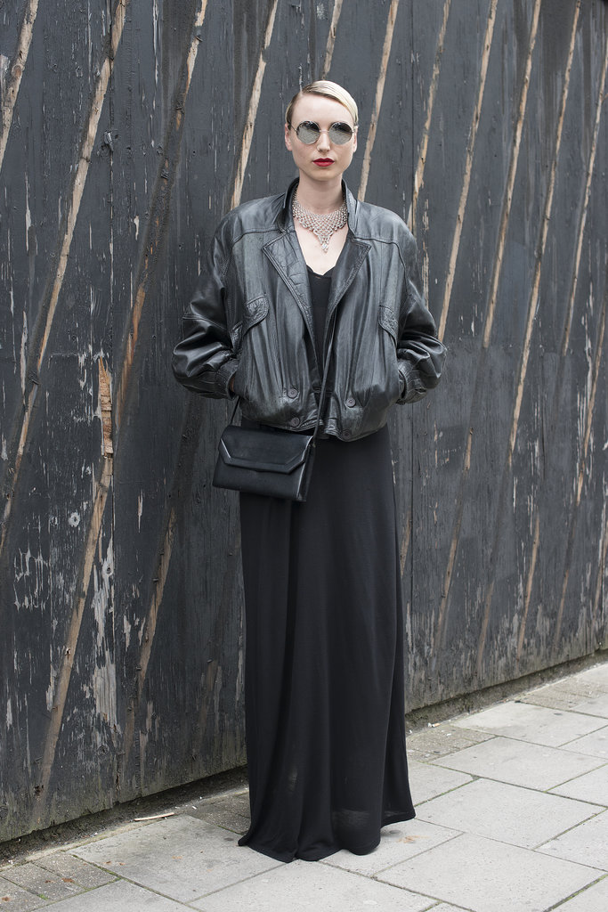 All black is hardly boring when executed with rocker-girl appeal via circular sunglasses, an oversize leather jacket, and a gorgeous red pout.
