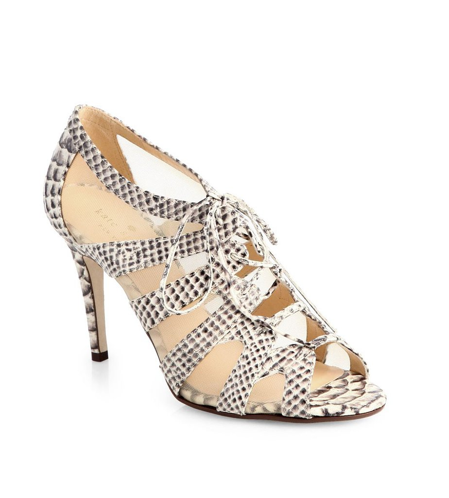Kate Spade takes the neutral, wear-with-everything sandal up a notch done in  snakeskin and nude mesh ($375).