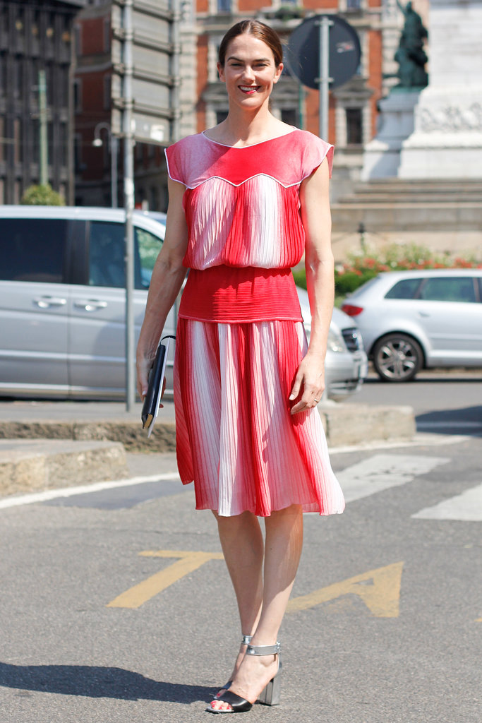 Saturated color and pretty pleats gave this sundress ample personality, but we love even more that she matched her lips to the gorgeous shade of red in her dress.