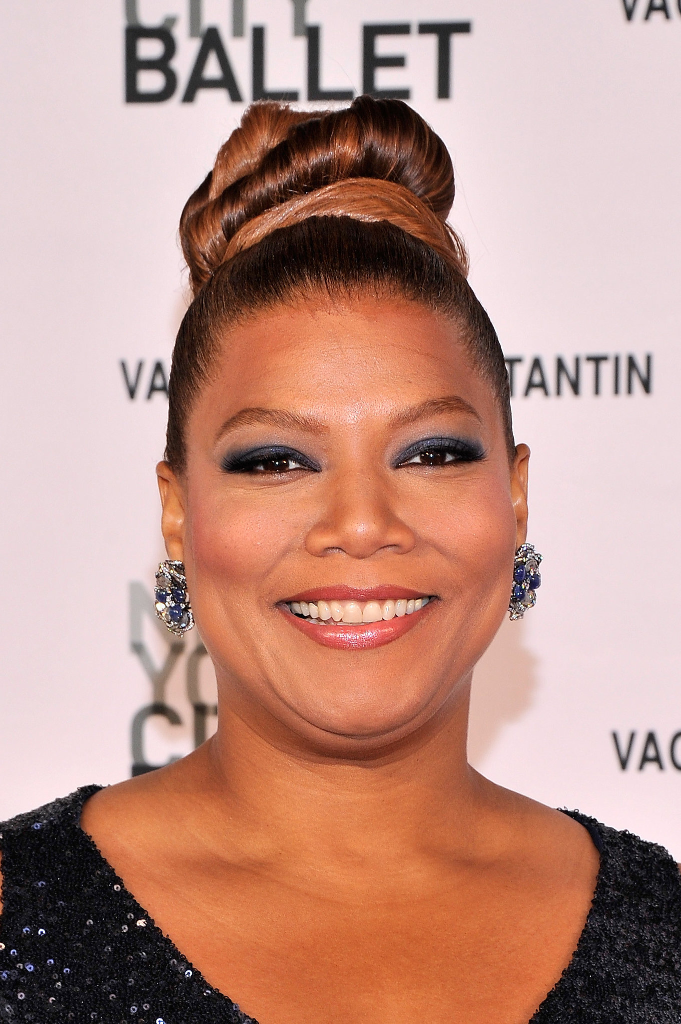 This topknot on Queen Latifah showcased her color job nicely.