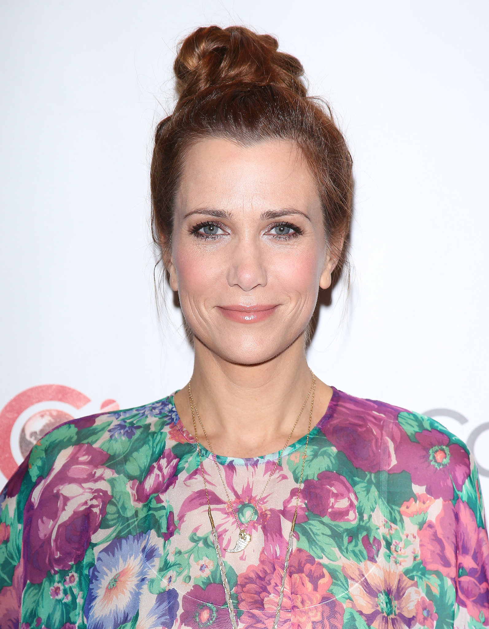 Kristen Wiig swept her hair up into a precarious topknot that will keep your hair color safe from chlorine when you take a dip this Summer.