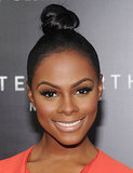 To get a simply sleek knot similar to Tika Sumpter's, pull hair into a tight, high ponytail, then twist hair and pin.