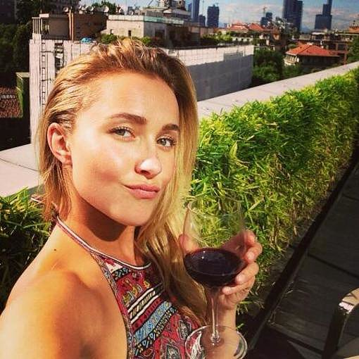 Hayden Panettiere enjoyed a glass of wine upon arriving in Milan, Italy, for the Giorgio Armani menswear show. Source: Twitter user haydenpanettier