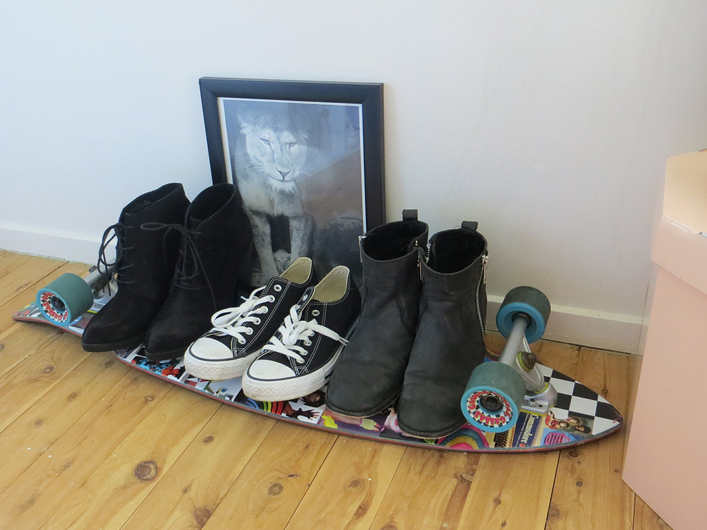 I like my room to be filled with my favourite things, but it all needs to make sense, too. Resting on this Gallaz skateboard are my everyday shoes: Topshop high-heel ankle boots, Converse sneakers, ASOS mid-heel ankle boots — the last of which I wear almost every day. Clearly, I don't know how to ride the skateboard.