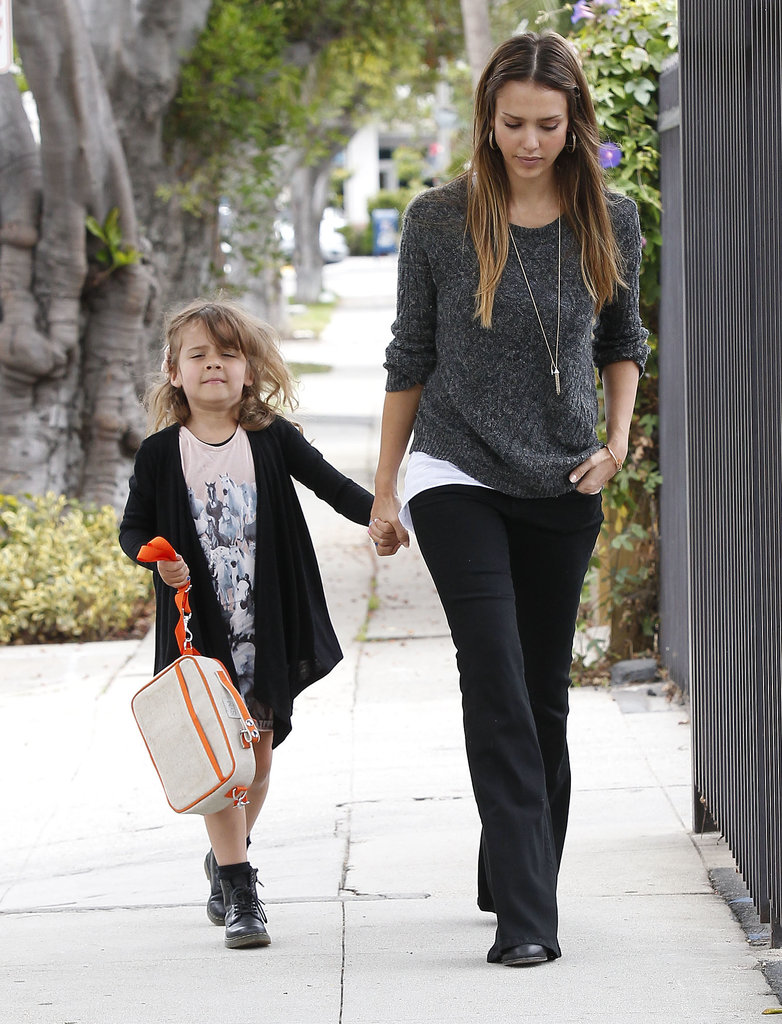Jessica toned things down in a gray Inhabit sweater, black wide-leg Level 99 jeans, and Nikki Reed x 7 For All Mankind necklace while dropping Honor off at school in LA.
