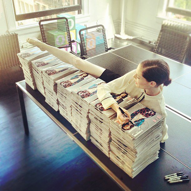 Coco Rocha made herself comfortable while signing magazine covers. Source: Instagram user cocorocha