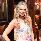 Molly Sims looked classically beautiful with glossy waves, a flick of a cat eye, and glossy pink lips.