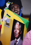 Supporters of the African National Congress put up posters near Mandela's former home in Johannesburg, South Africa.
