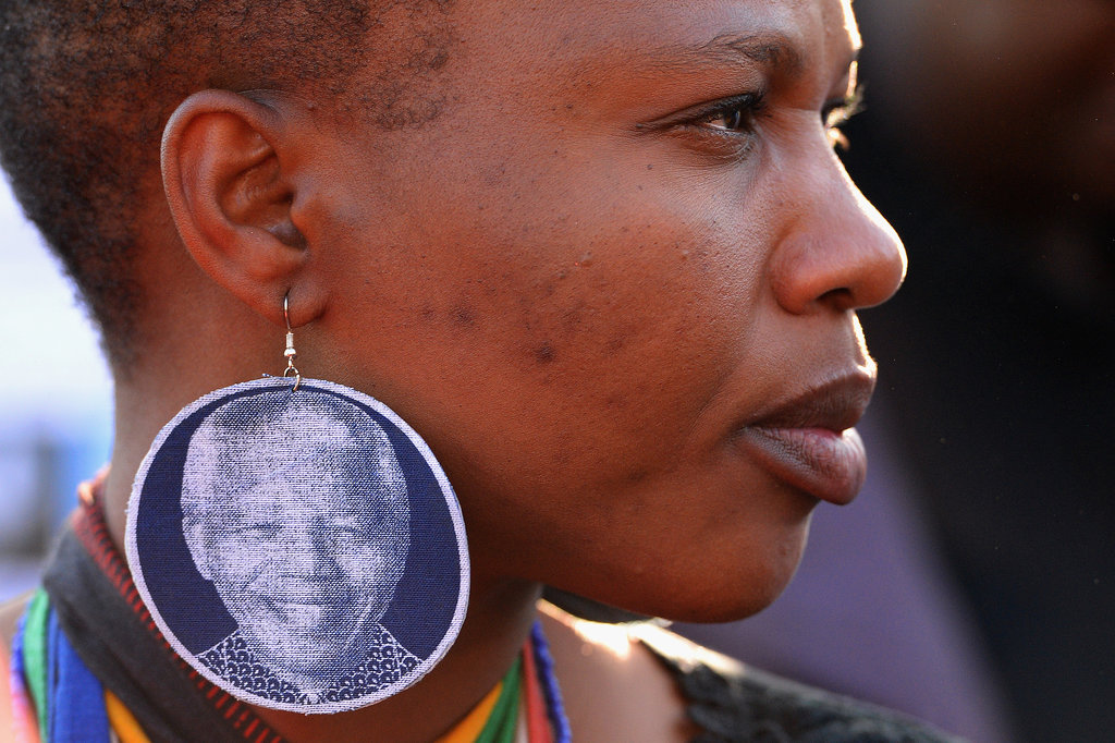 A woman sported earrings with Mandela's face on them to show her support.