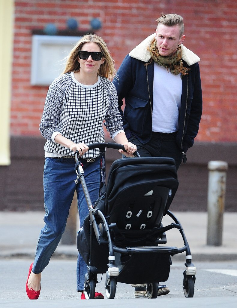 Go relaxed like Sienna Miller did by sporting a navy and white sweater with boyfriend jeans and snazzy red ballet flats.