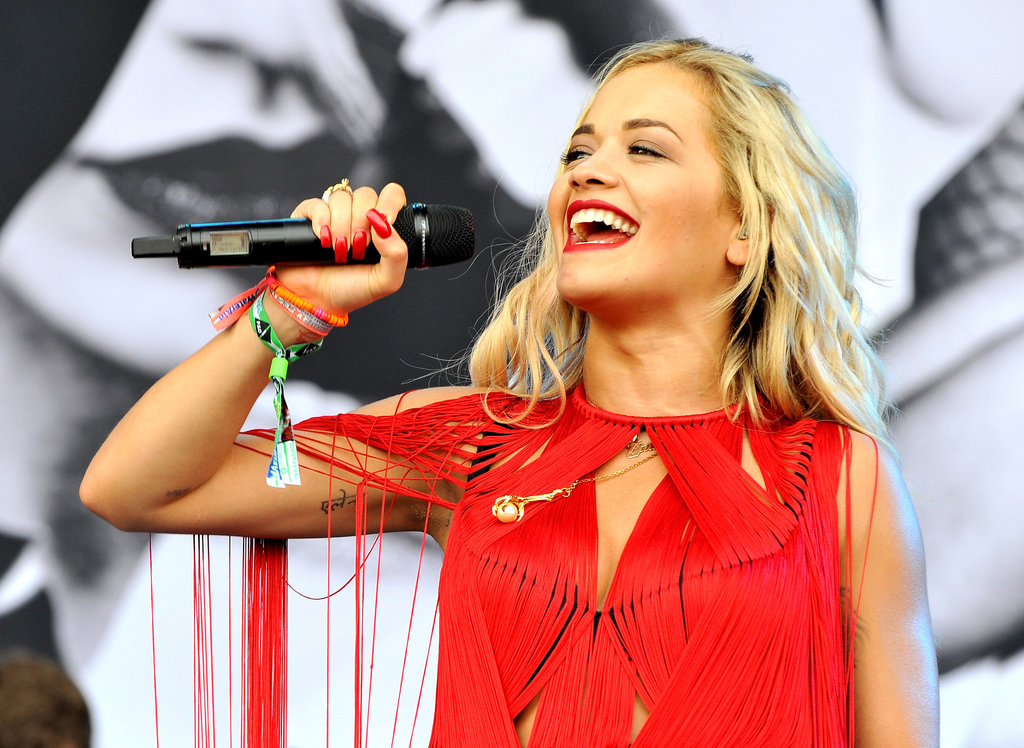 Rita Ora smiled on stage.