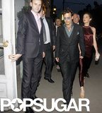 Johnny Depp held hands with Amber Heard in Moscow. Amber is carrying a Nancy Gonzalez clutch.