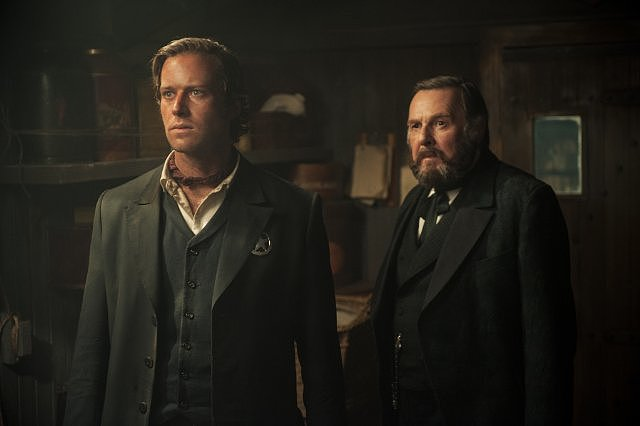 Armie Hammer and Tom Wilkinson in The Lone Ranger.