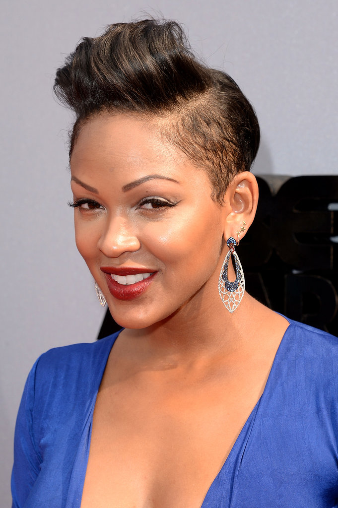 Meagan Good showed off her shaved sides by wearing her pixie cut in a pompadour style. For her makeup, she worked a dark maroon lipstick and winged liner.