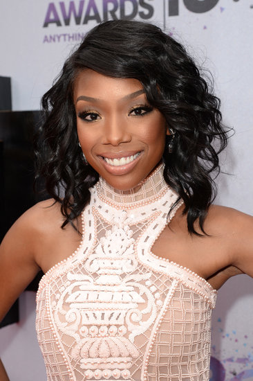 Brandy Norwood wore her graduated bob in curls with a neutral, brown-toned makeup palette.