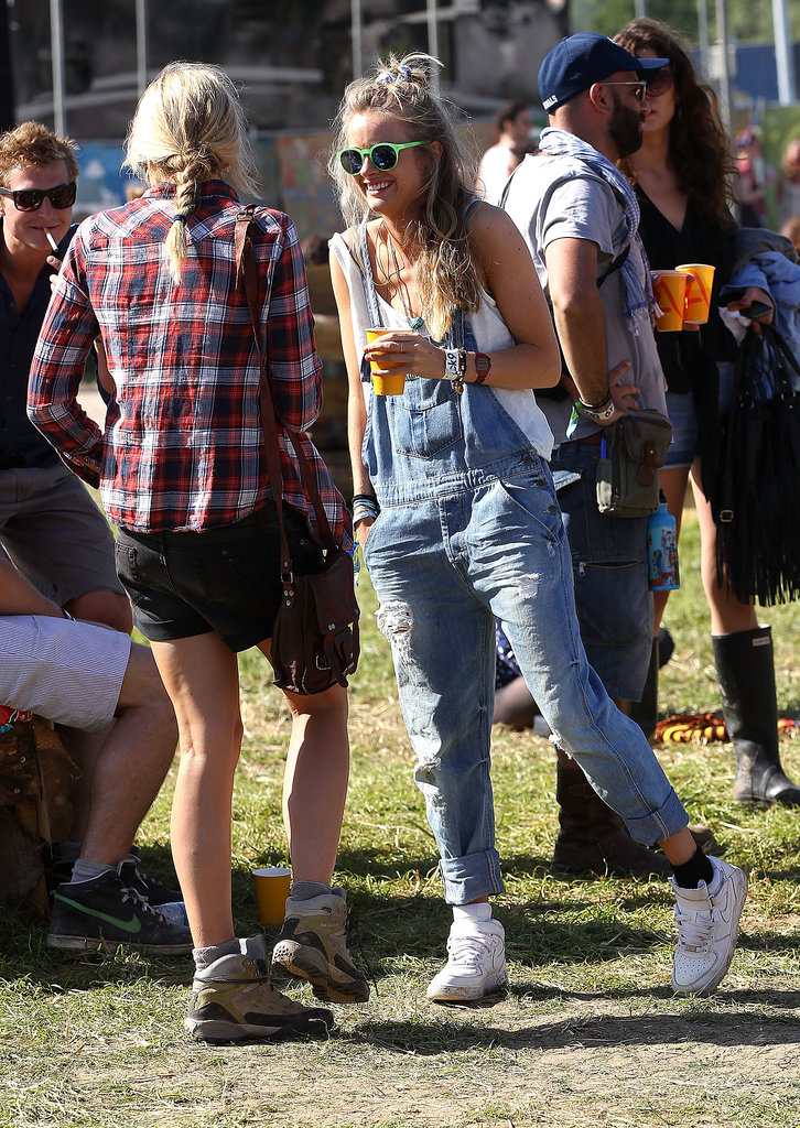 Rumored girlfriend to Prince Harry, Cressida Bonas showed off a Glastonbury look we can't quite picture Kate Middleton in: cuffed overalls, white sneakers, and neon green shades.