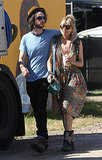 To take in a show with guy Tom Sturridge, Sienna Miller picked a boho floral dress and motorcycle boots.