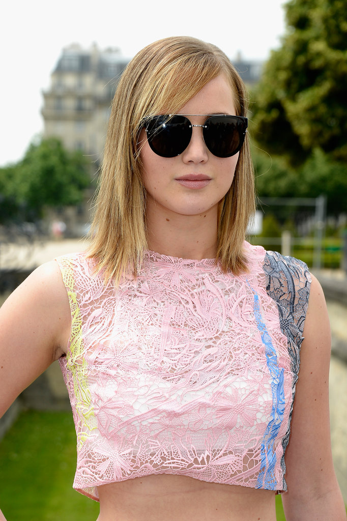 Attending Dior's show in a crop top — she's also the face of Miss Dior — Jennifer Lawrence went for a simple beauty look. She went with straight strands and a pale pink on her lips. Under her sunglasses, she sported a basic smoky eye.