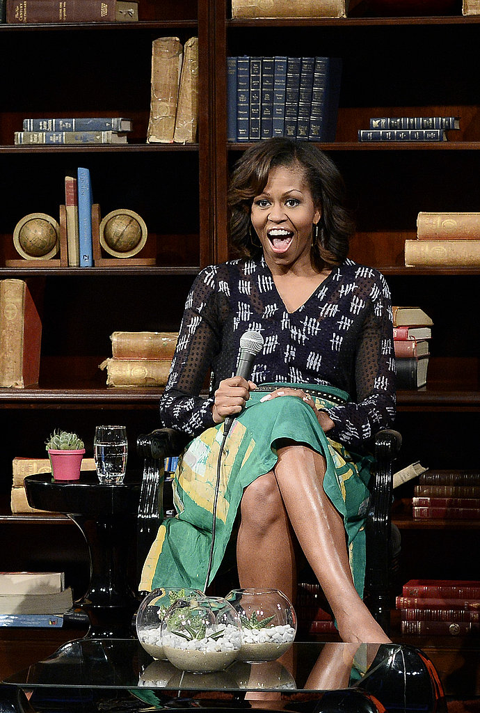 The first lady showed her enthusiasm (and style) in a black and white Maki Oh blouse and a green printed skirt in Johannesburg.