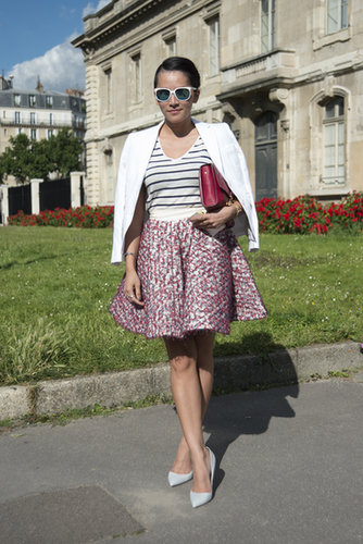 A bold flared skirt is comfortable and makes for a pretty silhouette. It gives an instant feminine touch to everything else you're wearing, too.