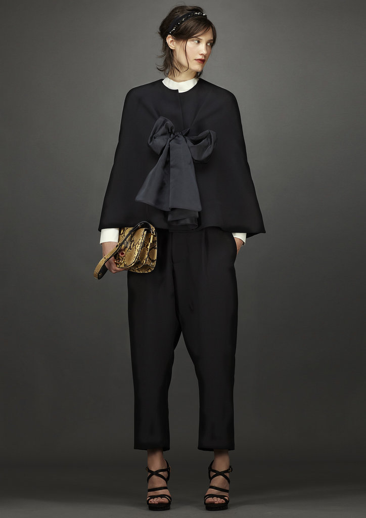 An oversize bow adds drama to this not-so-basic black. Source: Marni
