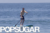 Tom Cruise showed off his toned physique for a paddle boarding session in Malibu in June 2013.
