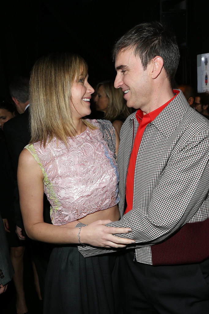 Jennifer Lawrence and Raf Simons chatted backstage at the Christian Dior Haute Couture show on Monday.