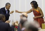 President Obama and First Lady Michelle clinked their glasses together while visiting Pretoria, South Africa, in June.