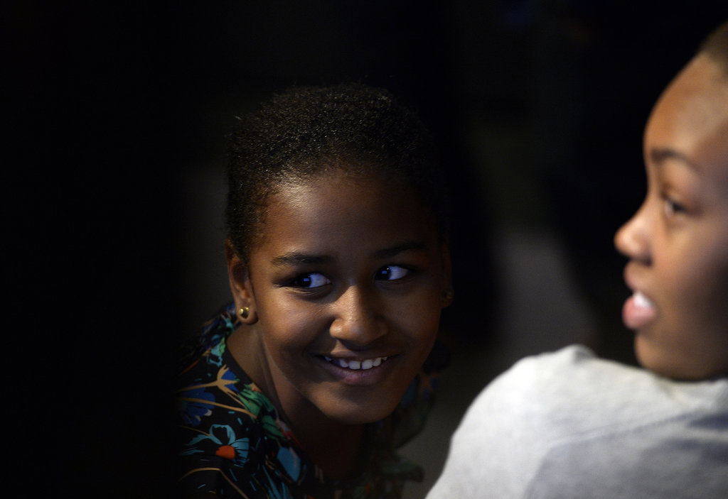 Sasha Obama smiled from the audience while First Lady Michelle Obama spoke with students in Johannesburg in June.