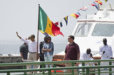 President Obama waved as he and Malia walked from a boat off the coast of Dakar in June.