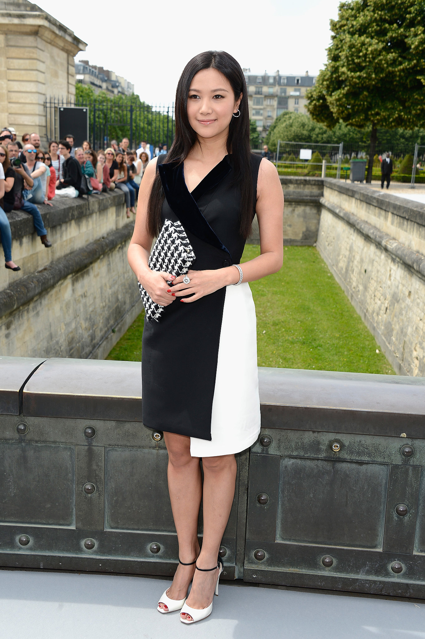 Black and white, always graphic, looked even more cerebral as a minimalistic layered sheath outside of the Dior show.