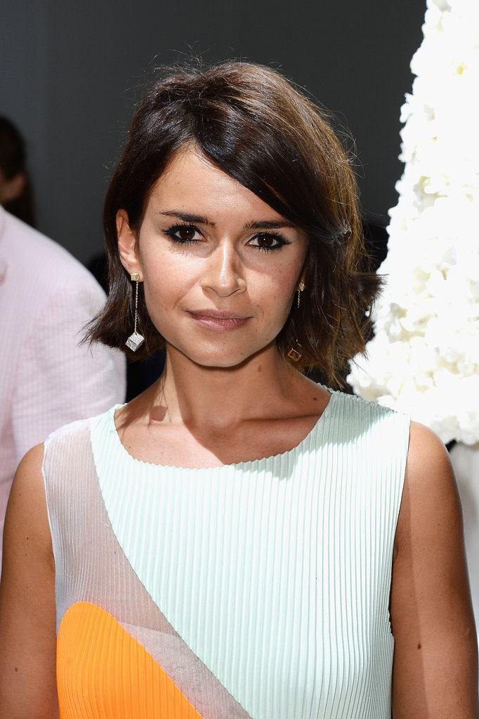 For her appearance at Giambattista Valli's Haute Couture showing, Miroslava Duma opted for her go-to nude makeup look with inky liner and a slightly flipped-out hairstyle.