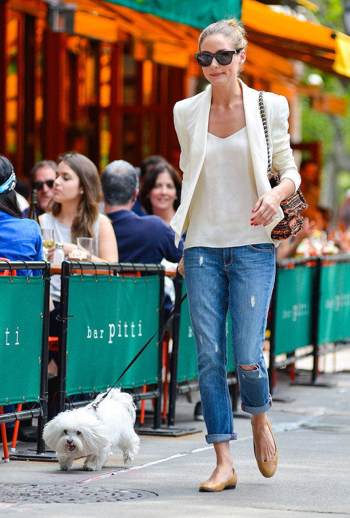 To give your favorite jeans a summery spin, just add a white tank and matching blazer like Olivia Palermo did while walking her pup in NYC.
